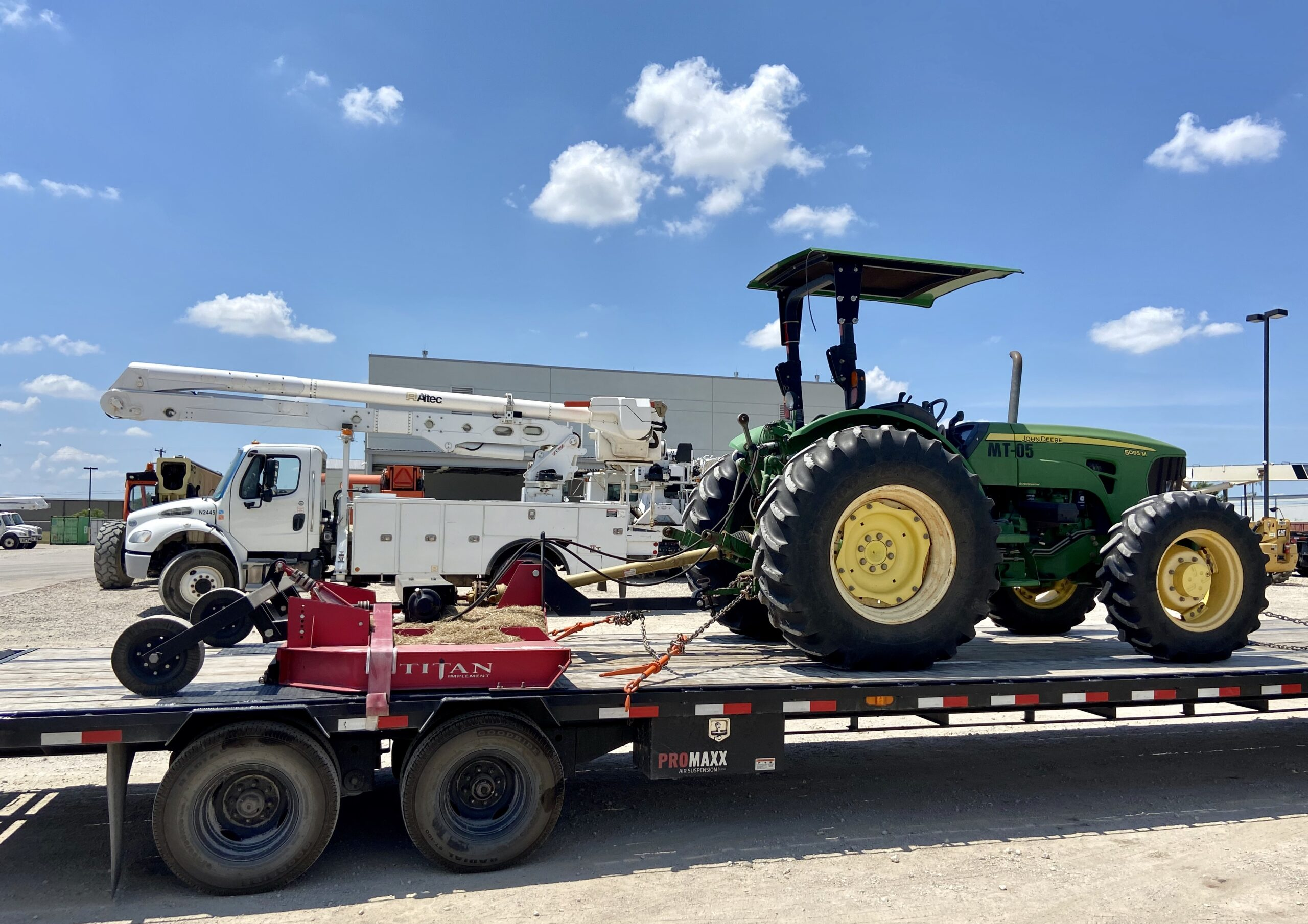 tractor on hot shot trailer